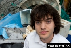 Dutch inventor Boyan Slat stands next to a pile of plastic garbage prior to a 2017 press conference in Utrecht, Netherlands.