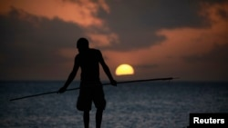 FILE - An Aboriginee is seen spear fishing in Australia's Northern Territory.
