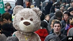 A performer dressed as a bear entertains Eurostar passengers queueing for trains at St Pancras station, in London. Snow and freezing temperatures grounded flights and disrupted road and rail links across northern Europe on Monday, stranding travellers and