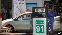 A worker refuels a car at a gas station in Jiddah, Saudi Arabia, Monday, Sept. 16, 2019.
