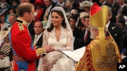 Britain's Prince William and Kate Middleton exchange rings in front of the Archbishop of Canterbury at Westminster Abbey, London, Friday April 29, 2011.
