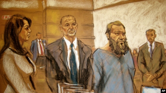FILE - In this courtroom sketch, Muhanad Mahmoud Al Farekh, third from left, appears in federal court in New York, April 2, 2015.