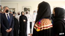 US Secretary of State Antony Blinken (L) and Qatar's assistant Foreign Minister Lolwah al-Khater (3rd L) meet with Afghan all-female robotics team members at Qatar's Education City Club House in Doha on September 7, 2021.