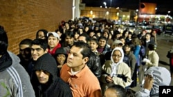 Hundreds of early-morning shoppers get in line the night before hoping to snag a deal on Black Friday at Best Buy in Atlanta, 26 Nov 2010