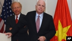 US Senator John McCain (R) speaks next to US Senator Joseph Lieberman (on left) at a press conference in Hanoi on January 19, 2012.