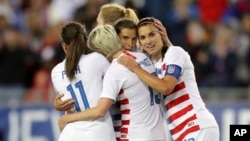 United States' Tobin Heath, second from right, is congratulated on her goal by Mallory Pugh (11), Megan Rapinoe and Alex Morgan (13) during soccer match against Brazil Tuesday, March 5, 2019, in Tampa, Fla. (AP Photo/Mike Carlson)