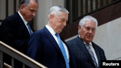 Secretary of Defense James Mattis and Secretary of State Rex Tillerson arrive to brief the Senate Foreign Relations Committee on Capitol Hill in Washington, Aug. 2, 2017.