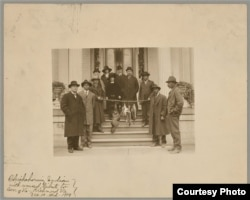 Chickahominy tribe paying annual tribute of game animals to Virginia governor, Dec. 10, 1919, a ceremony still observed today. Then-chief Ozias Westmore Adkins (third from left) served as chief from 1918 until his death in 1939. BAE 1-9 01787700, Nationa