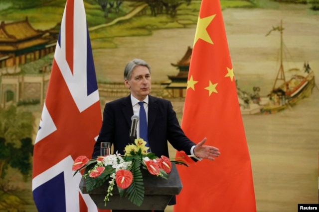 British Foreign Secretary Philip Hammond speaks at a joint news conference with China's Foreign Minister Wang Yi (not seen) after a meeting at the Ministry of Foreign Affairs, in Beijing, China, Jan. 5, 2016.