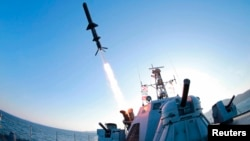 A North Korean People's Army naval unit tests a new type of anti-ship cruise missile in this undated photo released by the Korean Central News Agency in Pyongyang, Feb. 7, 2015.