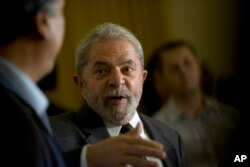 FILE - Brazil's former President Luiz Inacio Lula da Silva speaks during a press conference.