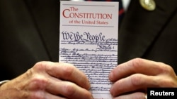 A member of Congress holds a copy of the U.S. Constitution. (File)