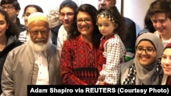 Congresswoman Rashida Tlaib poses with supporters outside her office at the Longworth House Office Building (LHOB), in Washington, D.C., Jan. 3, 2019 in this image obtained from social media. (Adam Shapiro via Reuters)
