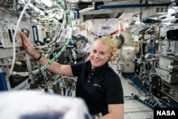 NASA astronaut and Expedition 64 Flight Engineer Kate Rubins works on research hardware inside the JAXA (Japan Aerospace Exploration Agency) Kibo laboratory module. (Photo courtesy of NASA)