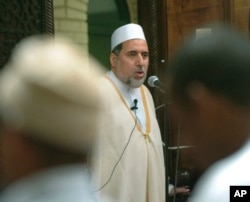 FILE - Imam Shaker Elsayed delivers the sermon at prayers services at the Dar al-Hijra mosque in Falls Church, Va., June 15, 2005.