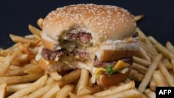 A photo of a partially-eaten McDonalds' Big Mac hamburger atop French fries, November 2, 2010.
