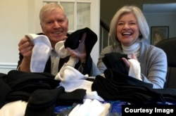 Tom Costello, Jr. founder and chief sock person with wife Nancy Costello with what else...a pile of new socks