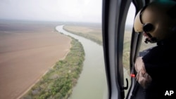 FILE - U.S. Customs and Border Protection Air and Marine agents patrol along the Rio Grande on the Texas-Mexico border near Rio Grande City, Texas, Feb. 24, 2015.