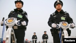 FILE - Police officers secure the area around Beijing's Great Hall of the People.