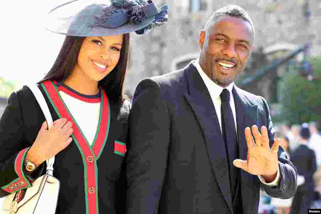 ادریس البا بازیگر بریتانیایی به همراه نامزدش در مراسم ازدواج شاهزاده هری و مگان