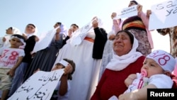 Yazidi women cry as they attend a demonstration at a refugee camp in Kurdish-dominated city of Diyarbakir, Turkey, to mark the second anniversary of what a U.N.-appointed commission of independent war crimes investigators termed a genocide against the Yazidi.