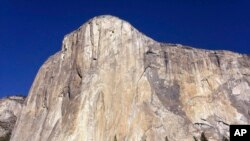 This photo shows El Capitan in Yosemite National Park, Calif. An American rock climber has become the first to climb alone to the top of the wall without ropes or safety gear.