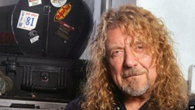 In this July 30, 2010 photo, singer Robert Plant poses for a portrait backstage moments before performing with Band Of Joy at Miami's Bayfront Amphitheatre
