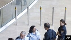 Israeli police officers stand at the arrival hall at Ben Gurion airport near Tel Aviv , July 6, 2011