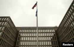 The U.S. national flag is pictured at the Office of Personnel Management building in Washington, June 5, 2015.