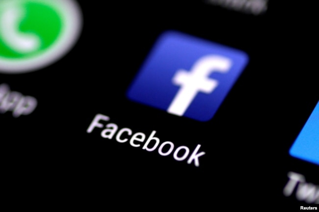 FILE - The Facebook icon is seen on a phone screen.