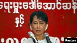 Aung San Suu Kyi speaks with youths at the National League for Democracy (NLD) head office in Yangon February 8, 2011.