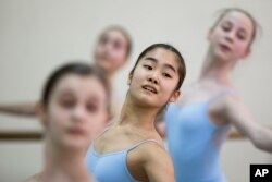 Students perform in a ballet class at the Bolshoi Ballet Academy in Moscow, March 3, 2016. The prestigious academy has 84 foreigners among its 721 students.