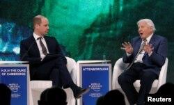 FILE - Britain's Prince William, Duke of Cambridge interviews naturalist Sir David Attenborough during the World Economic Forum (WEF) annual meeting in Davos, Switzerland, Jan. 22, 2019.