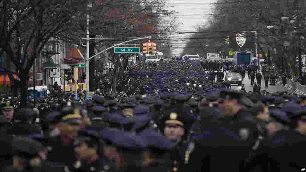 Police officers from across the country gather for the funeral of New York Police Department Officer Wenjian Liu at Aievoli Funeral Home, in the Brooklyn borough of New York, Jan. 4, 2015,.