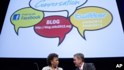 Rep. Barbara Lee, D-Calif., left talks with former Senate Majority Leader Bill Frist before a session at the XIX International AIDS Conference in Washington, July 25, 2012.