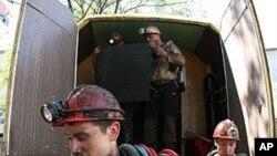 Rescuers unload equipment at Sukhodolskaya-Vostochnaya coal mine in Lugansk region, Ukraine, July 29, 2011