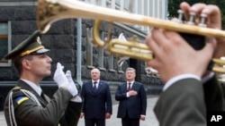 FILE - Ukrainian President Petro Poroshenko, background right, and Belarusian President Alexander Lukashenko, background left, listen to a national anthem during a welcome ceremony in Kiev, Ukraine, Friday, July 21, 2017. (AP Photo/Mykhailo Markiv, Presidential Press Service Pool Photo via AP)