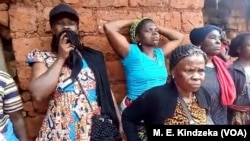 Morners in Minka, a village in Pinyin in Cameroon's northwestern region. English speaking Cameroonians are burying 30 members of their community who were killed on May 24, 2018, in the northwestern town of Pinyin.