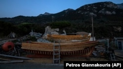 Wooden boats at Agios Isidoros boat building area on the eastern Aegean island of Samos, Greece, on Wednesday, June 9, 2021. (AP Photo/Petros Giannakouris)