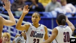 University of Connecticut's forward Maya Moore is congratulated by teammates against Florida State during the second half of their NCAA Women's basketball game in Hartford, Connecticut, 21 Dec 2010.