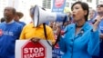 U.S. Congresswoman Judy Chu (D-Calif.) joins U.S. Post Office employees during a protest outside a Staples store on April 24, 2014 in Los Angeles.
