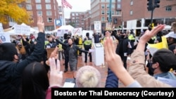 Pro-Thai democracy protesters make a three-finger salute during a clash between pro-Thai democracy protesters and Thai royalists during the demonstration at King Bhumibol Adulyadej Square in Cambridge, MA Nov 1, 2020.