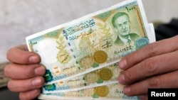 The Syrian pound is plunging in value on the black market, trading this past week for more than 300 to a U.S. dollar.