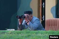 North Korean leader Kim Jong Un watches the test-fire of two short-range ballistic missiles, in this undated picture released by North Korea's Central News Agency, July 26, 2019.