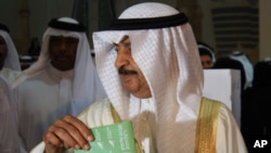 Bahrain's Prime Minister Khalifa bin Salman al-Khalifa votes in his country's parliamentary elections, 23 Oct 2010