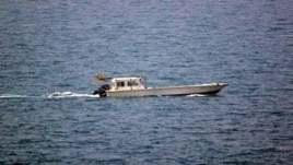 A photo provided by the U.S. Navy shows a small vessel that was fired upon by the U.S. Navy off Dubai's coast on Monday, July 16, 2012.