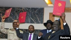 Abafasha mu kwumvikanisha abanyesudani berekana amasezerano y'amahoro no guhagarika intambara i Juba, kw'itariki 21/10/2019.