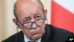 France's Foreign Minister Jean-Yves Le Drian listens during a news conference after his talks with Russian counterpart Sergey Lavrov, in Moscow, Sept. 8, 2017.