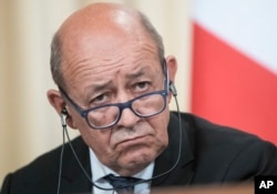 FILE - France's Foreign Minister Jean-Yves Le Drian listens during a news conference after his talks with Russian counterpart Sergey Lavrov, in Moscow, Sept. 8, 2017.