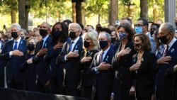 From left, former President Bill Clinton, Hillary Clinton, former President Barack Obama, Michelle Obama, President Joe Biden, first lady Jill Biden and others are pictured at the National 9/11 Memorial and Museum, Sept. 11, 2021, in New York.